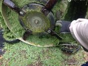 Cleaning underside of mower after mowing in the rain