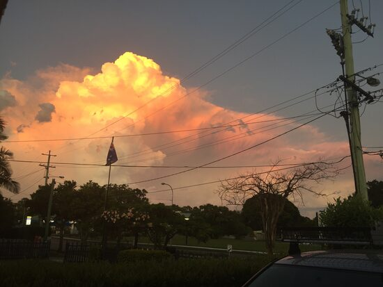 Sun setting on cumulonimbus cloud